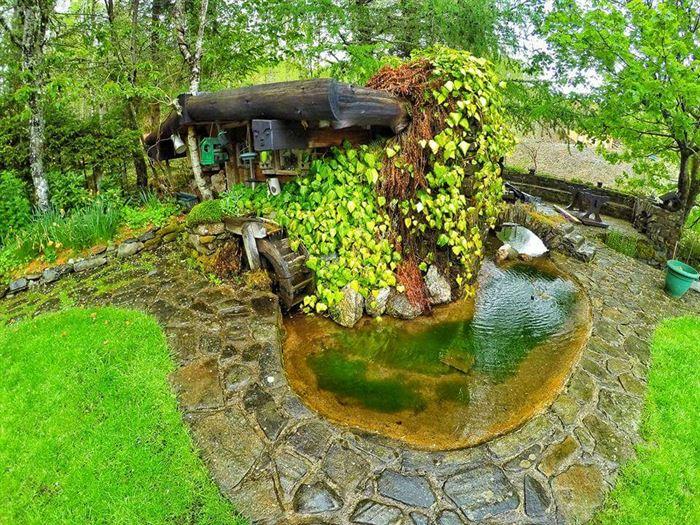 İlginç Doğal Ahşap Tasarımlı Hobbit Tarzı Ev 6