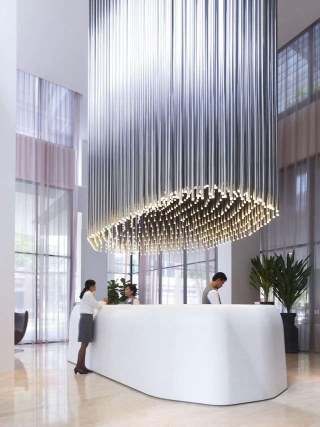 ilginc-tasarimli-resepsiyon-masasi-modelleri resepsiyon masası - minimalist reception desk eye cathing - İlginç Tasarımlı Resepsiyon Masası Modelleri